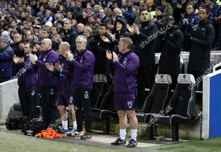 The Derby bench take part in the minutes applause for the passing of Dave Mackay.