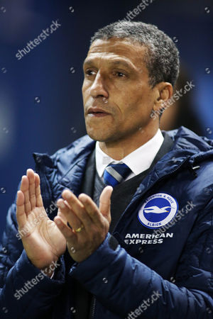 Brighton & Hove Albion Manager Chris Hughton takes part in the minutes applause for Dave Mackay.