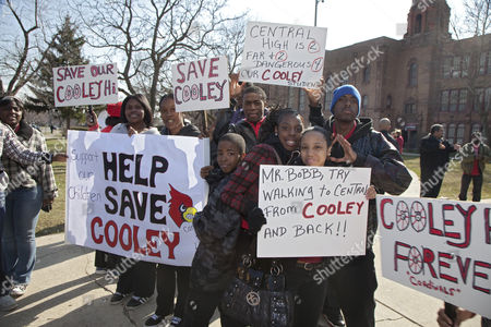 Students and alumni at Cooley High School march through the streets on Detroit's west side to protest plans to close their school, as one of 45 schools that Detroit Public Schools Emergency Financial Manager Robert Bobb plans to close, Detroit, Michigan, USA