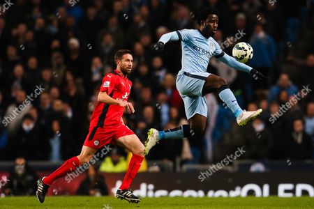 Manchester City's Wilfried Bony and Matthew Upson of Leicester City in action- Photo mandatory by-line: Matt McNulty/JMP