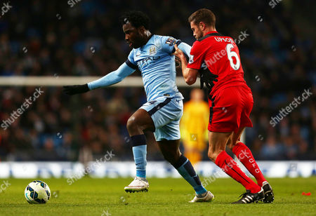 Wilfried Bony of Manchester City and Matthew Upson of Leicester City