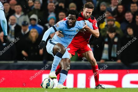Manchester City's Wilfried Bony holds off Matthew Upson of Leicester City