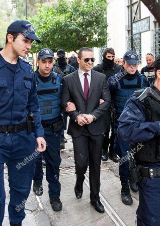 Ilias Kasidiaris arrives under police guard