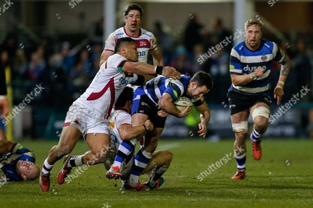 Bath replacement Micky Young is tackled by Sale Sharks Scrum-Half Chris Cusiter and Outside Centre Johnny Leota