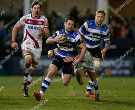 Bath replacement Micky Young is tackled by Sale Sharks Scrum-Half Chris Cusiter
