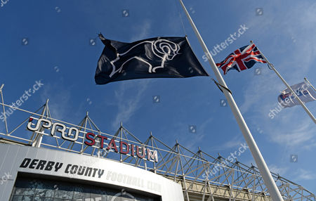 The Derby County flag flying at half mast outside the iPro Stadium as a tribute to former player Dave Mackay who passed away