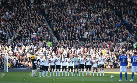 Derby County players join in the minute's applause as they pay tribute to former player Dave Mackay who passed away