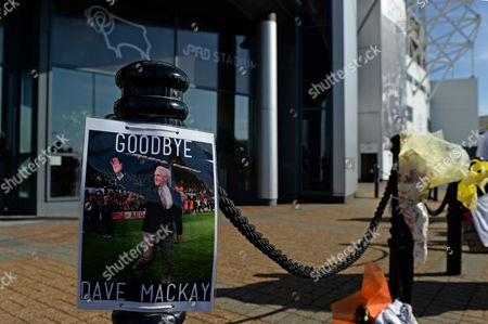 Floral tributes outside the iPro Stadium as a tribute to former player Dave Mackay who passed away
