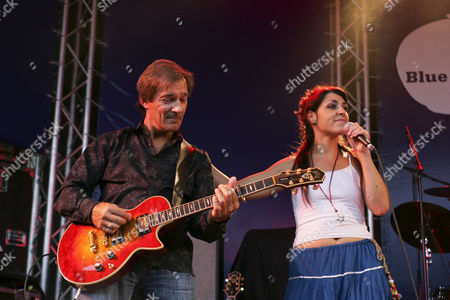 Werner Wirz, guitarist, and Jessica Knoll, singer and front woman of the Swiss band Dust live at Blue Balls Festival in the Pavillon am See venue in Lucerne, Switzerland