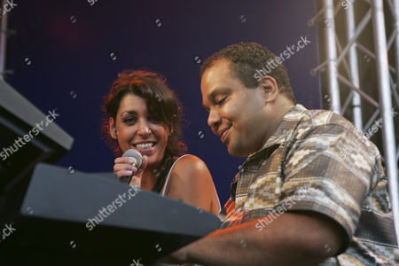 Jessica Knoll, singer and front woman, and Marc Glaser, keyboardist of the Swiss band Dust live at Blue Balls Festival in the Pavillon am See venue in Lucerne, Switzerland
