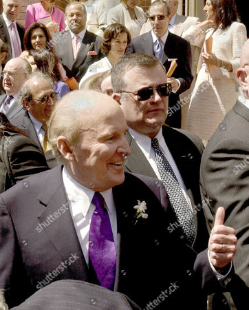 Jack Welch giving the thumbs up as he exits the church