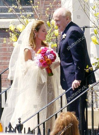Susie Wetlaufer and Jack Welch at the steps of her Boston home