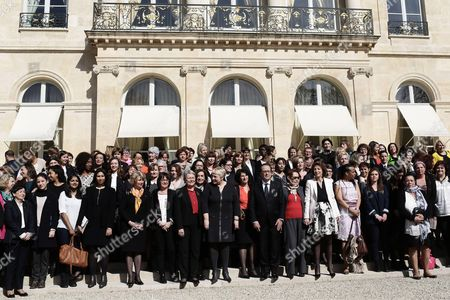 French President Francois Hollande and French Junior Miniser for Women's Rights Pascale Boistard pose with women in the gardens of the Elysee Palace after a panel discussion to mark International Womens Day in Paris