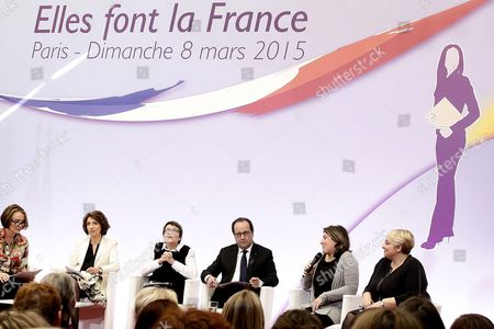 French President Francois Hollande flanked by Secretary of state Women's Rights Pascale Boistard and French minister for Social Affairs, Health and Women's Rights Marisol Touraine takes part to an event attended by 100 invited women to mark International Women's Day at the Elysee Palace