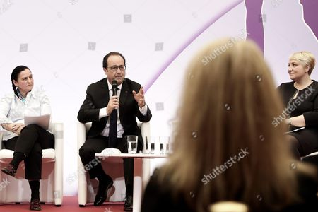 French President Francois Hollande flanked by Secretary of state Women's Rights Pascale Boistard takes part to an event attended by 100 invited women to mark International Women's Day at the Elysee Palace in Paris