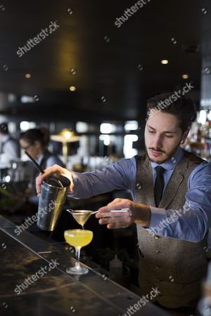 A cocktail waiter prepares a drink at the City Social Restaurant, ran by Chef Jason Atherton in the Tower 42 building