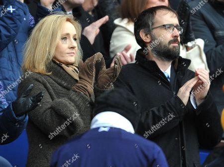 J.K. Rowling and her husband Dr. Neil Murray watch from the stand