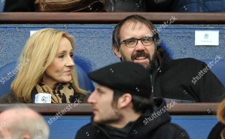 Stock Image of J.K. Rowling and her husband Dr. Neil Murray watch from the stand