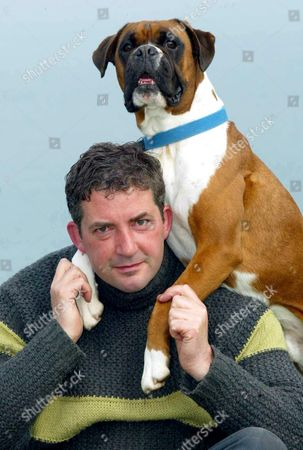 DOG OWNER MARTIN GREENWOOD WITH BOXER DOG BENSON