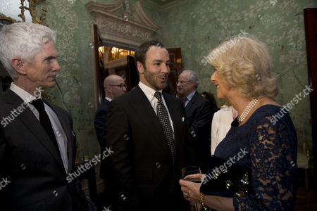 Camilla Duchess of Cornwall, meets U.S. fashion designer Tom Ford, center, and his husband, writer and journalist, Richard Buckley