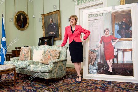 Scottish First Minister Nicola Sturgeon with her portrait by Gerard Burns