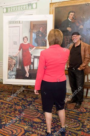 Stock Photo of Scottish First Minister Nicola Sturgeon and Gerard Burns with his portrait of her