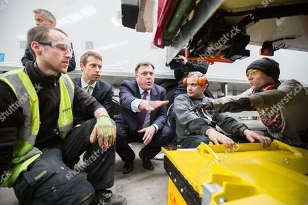 Stock Picture of Will Straw, Ed Balls discussing customised lorries with staff