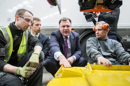 Will Straw, Ed Balls discussing customised lorries with staff