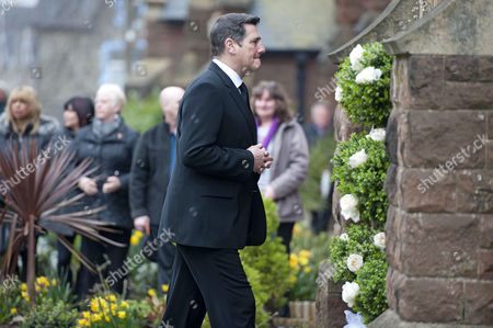 Spandau Ballet singer Tony Hadley enters the church during the funeral