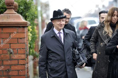 Stephen Jones OBE arriving for the funeral