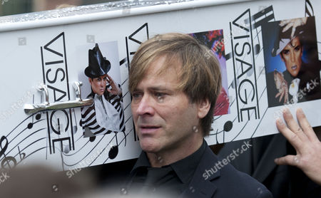 Steve Norman of Spandau Ballet carries the coffin to the hearse