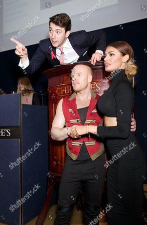 Auctioneer, Philip Christopher Baldwin & Chloe Sims modelling jewellery