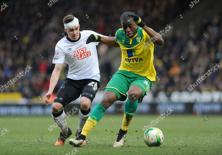 Derby's Jamie Hanson and Norwich's Sebastian Bassong- Norwich City v Derby County. Sky Bet Championship. Picture By Rob Howarth. 17.01.2015