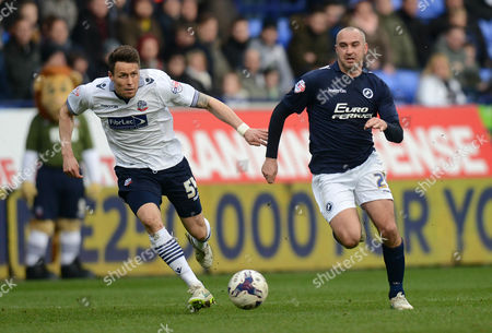 Millwall's Gary Taylor-Fletcher competes with Bolton Wanderers' Paddy McCarthy