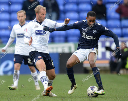 Bolton Wanderers' Eidur Gudjohnsen competes with Millwall's Shaun Cummings