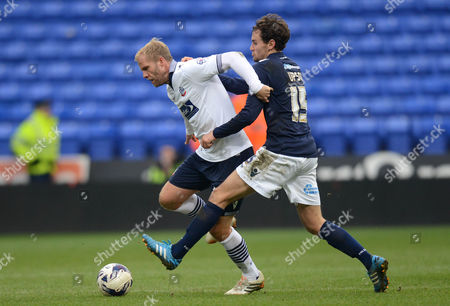 Bolton Wanderers' Eidur Gudjohnsen holds off Millwall's Edward Upson