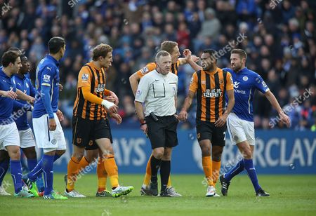 Leicester City's Matthew Upson and Hull City's Michael Dawson clash as players surround referee Jonathan Moss as he makes a booking