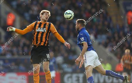 Leicester City's Matthew Upson battles with Hull City's Nikica Jelavic