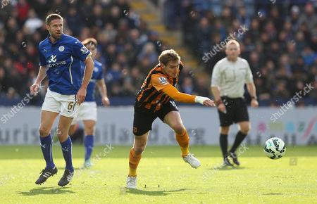 Hull City's Nikica Jelavic turns away from Leicester City's Matthew Upson