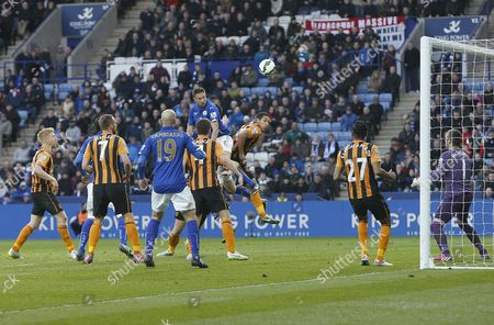 Leicester City's Matthew Upson heads at goal but it is saved
