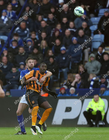 Leicester City's Matthew Upson keeps hold of Hull City's Dame N'Doye