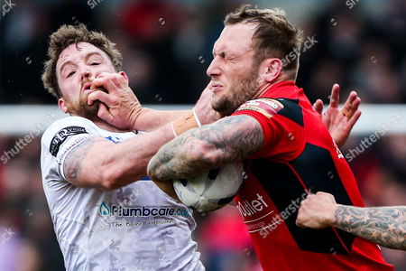 Picture by Alex Whitehead/SWpix.com - 15/03/2015 - Rugby League - First Utility Super League - Salford Red Devils v Wakefield Trinity Wildcats - AJ Bell Stadium, Salford, England - Salford's Josh Griffin is tackled by Wakefield's Danny Kirmond and Tim Smith (not pictured).