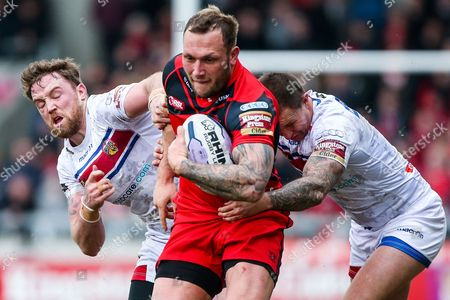 Picture by Alex Whitehead/SWpix.com - 15/03/2015 - Rugby League - First Utility Super League - Salford Red Devils v Wakefield Trinity Wildcats - AJ Bell Stadium, Salford, England - Salford's Josh Griffin is tackled by Wakefield's Danny Kirmond and Tim Smith.