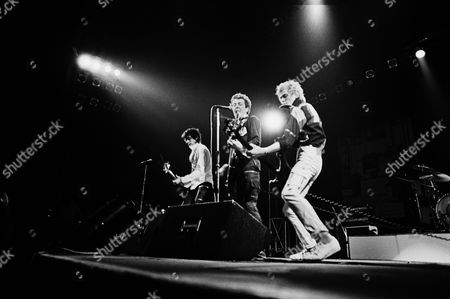 The Clash in concert at the Rainbow Theatre, London - Mick Jones, Joe Strummer and Paul Simenon