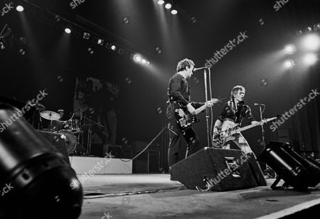 The Clash in concert at the Rainbow Theatre, London - Joe Strummer and Paul Simenon
