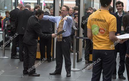 Michael Crick, TV presenter, passes thorough security.