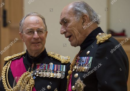 Former Chief of Defence Staff Sir David Richards (L) speaks with General Sir Michael Jackson at a reception at the Honourable Artillery Company in London