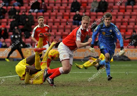 MK Dons Devante Cole (on floor) beats Crewe's Alan Tate to the ball to score their opening goal