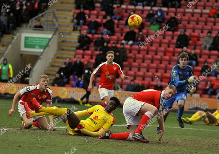 MK Dons Devante Cole gets between Crewe's Harry Davis and Alan Tate to score their opening goal