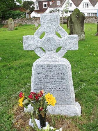 The headstone is inscribed in Gaelic - part of it reads 'I told you I was ill !'